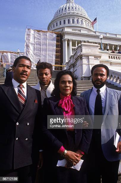 American civil rights campaigner and widow of Dr Martin Luther King Jr Coretta Scott King poses on the steps of the capital building with her sons...