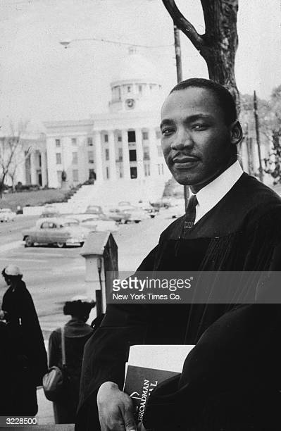 American civil rights leader and minister the Reverend Martin Luther King Jr in his vestments as pastor of the Dexter Avenue Baptist Church in...