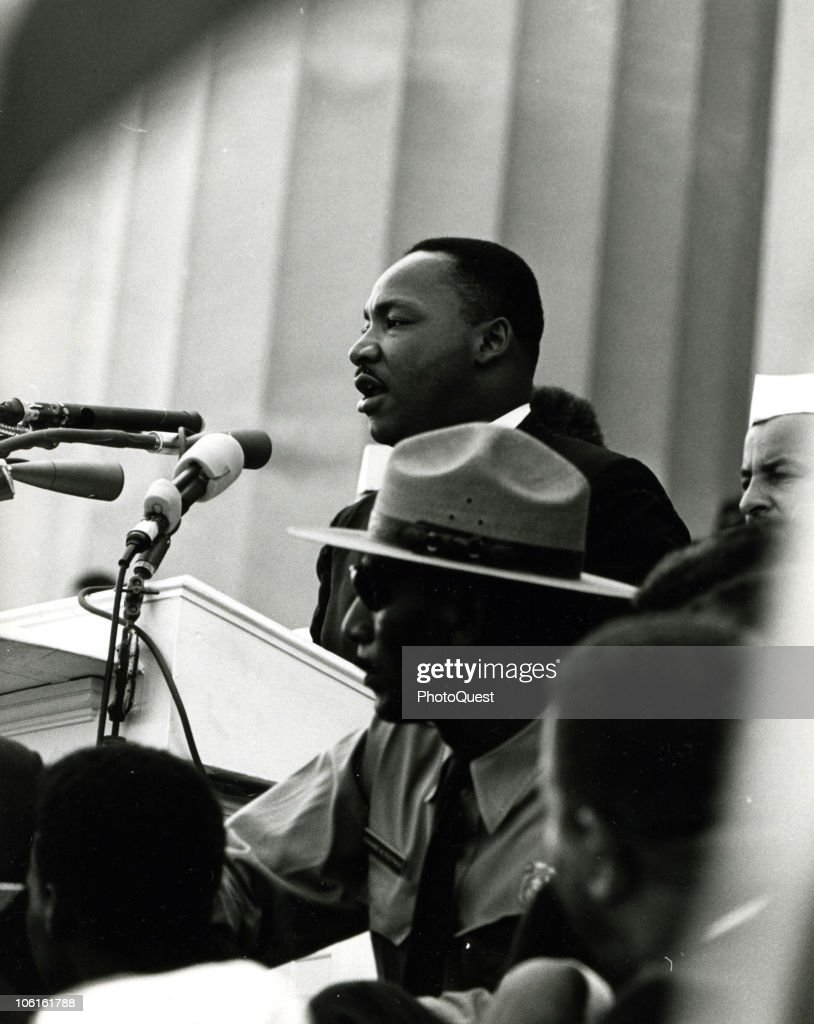 American Civil Rights leader Dr. Martin Luther King Jr. (1929 - 1968) (center) delivers his iconic 'I Have a Dream' speech from the steps of the Lincoln Memorial during the March on Washington for Jobs and Freedom, Washington DC, August 28, 1963.