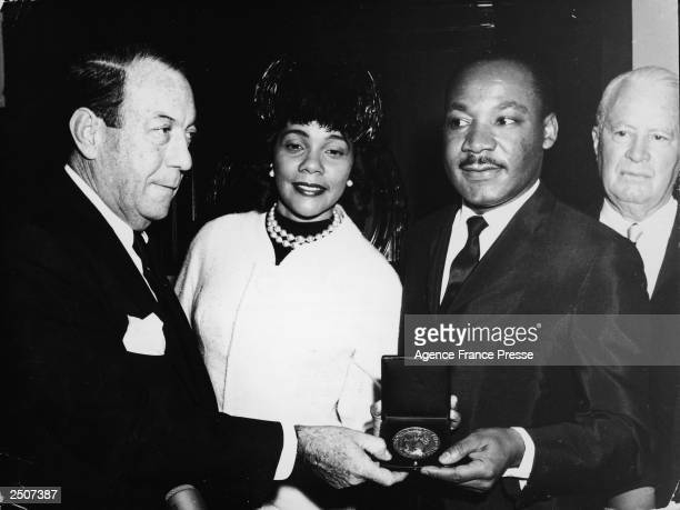 American civil rights leader Dr Martin Luther King Jr stands with his wife Coretta and New York City Mayor Robert F Wagner as is presented with the...
