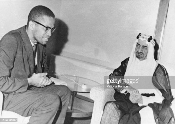 American civil rights leader Malcolm X sits and meets with Prince Faisal alSaud the regent of Saudi Arabia during a visit as a guest of state and as...