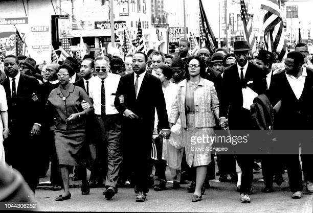 American Civil Rights leaders Dr Martin Luther King Jr and his wife Coretta Scott King lead others during on the Selma to Montgomery marches held in...