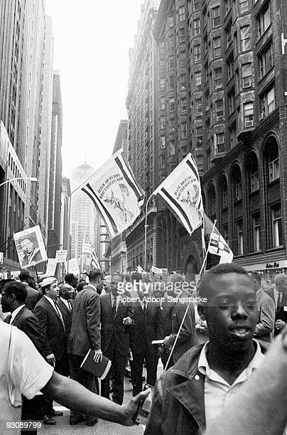 American Civil Rights leaders lead a protest march through the streets towards City Hall Chicago Illinois July 10 1966 Among those visible are center...