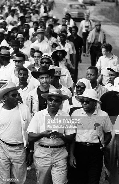 Martin Luther King Jr James Meredith and Dick Gregory walk together in the March Against Fear through rural Mississippi