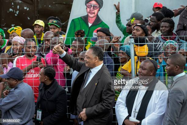 American Civil Rights stalwart Reverend Jesse Jackson gestures waits for the arrival of the coffin of Winnie Mandela late antiapartheid icon and...