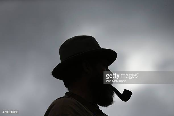 American Civil War reenactor Mark Stark dressed as a member of the Confederate cavalry smokes his pipe before taking part in drills early in the...