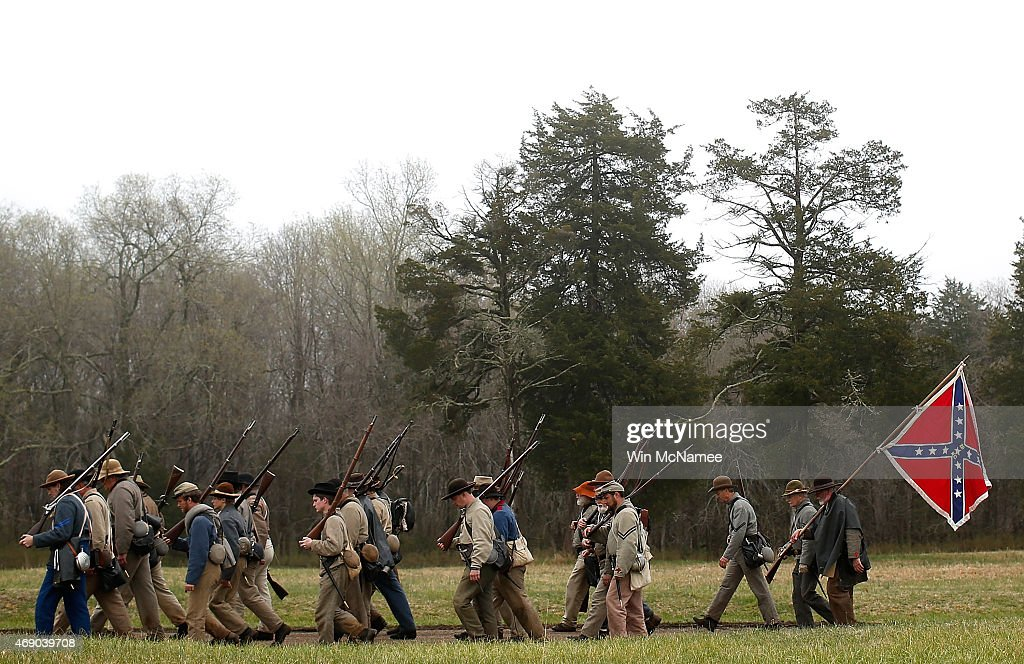 American Civil War re-enactors acting as members of the North Carolina 26th Infantry leave the field of battle following a re-enactment of the Battle of Appomattox Court House at the Appomattox Court House National Historical Park April 9, 2015 in Appomattox, Virginia. Today is the 150th anniversary of Confederate General Robert E. Lee's surrender of the Army of Northern Virginia to Union forces commanded by General Ulysses S. Grant in the McLean House at Appomattox, Virginia. The surrender marked the beginning of the end of the American Civil War in 1865.