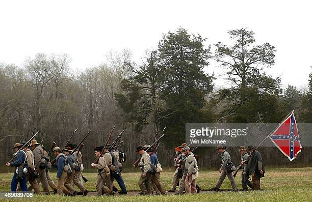 American Civil War reenactors acting as members of the North Carolina 26th Infantry leave the field of battle following a reenactment of the Battle...