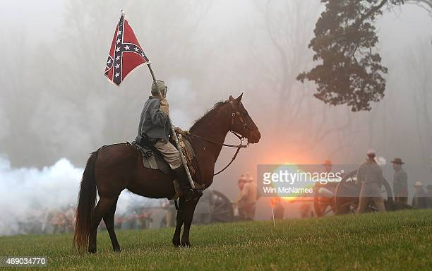 American Civil War reenactors dressed as Confederate cavalry and artillery take part in a reenactment of the Battle of Appomattox at the Appomattox...