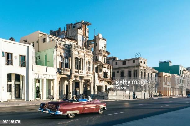 American classic car drives along Malecon, Havana, Cuba