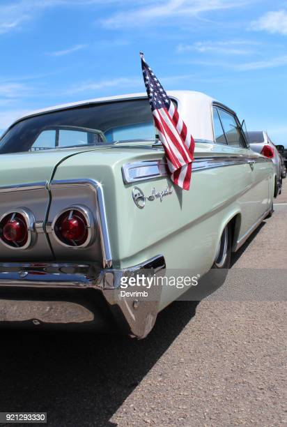 american classic car on the street - chevrolet impala stock pictures, royalty-free photos & images