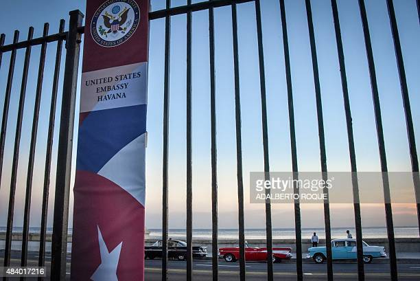 American classic cars are seen outside the US Embassy in Havana on August 14 during US Secretary of State John Ketty's visit Cuba is ready to discuss...