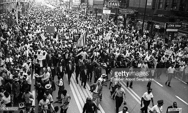 American clergyman and civil rights leader Dr Martin Luther King Jr marches with hundreds of supporters and members of the Chicago Freedom Movement...