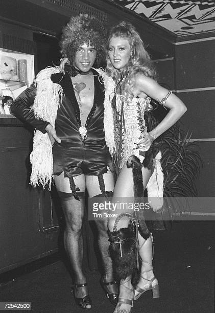 American clothing and costume designer Lennie Barin poses in lingerie with his girlfriend actress and model Christa Helm born Sandra Clements at his...