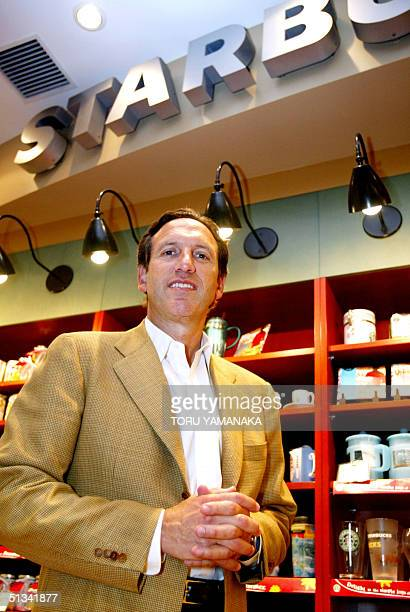 American coffee giant Starbucks Chairman Howard Schultz smiles at his coffee shop in Tokyo 26 June 2002 Schultz said the Starbucks would expand...