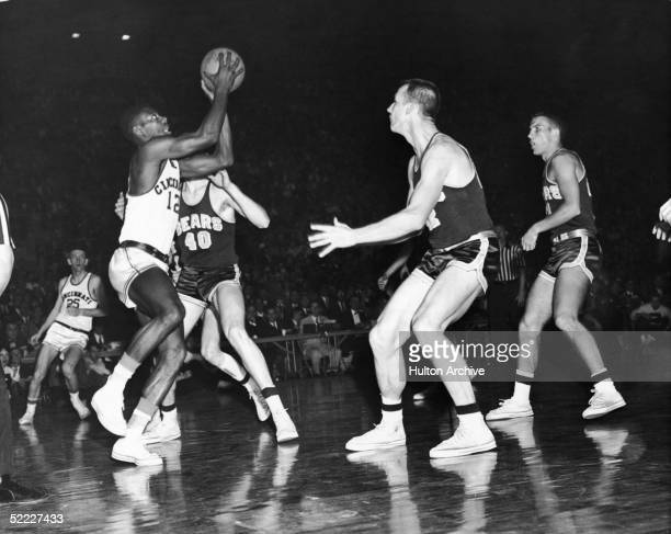 American college basketball player Oscar Robertson of the University of Cincinnati goes up for a shot surrounded by Bears California June 2 1959 LR...