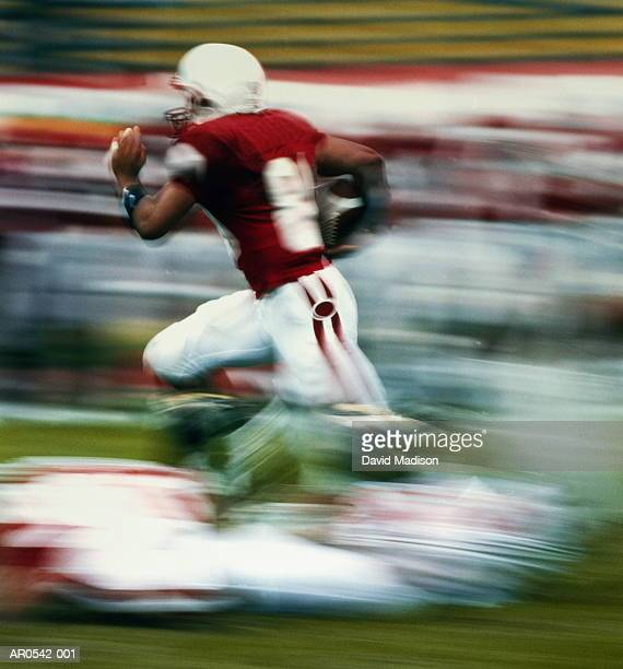 american college football player running (blurred motion) - rush american football stock pictures, royalty-free photos & images
