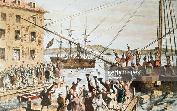 American colonists cheer as demonstrators dressed as Indians throw tea from British ships