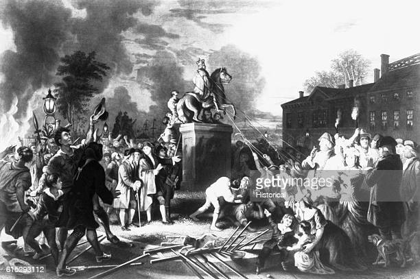 American colonists pull down a statue of King George III in New York City during the American Revolution