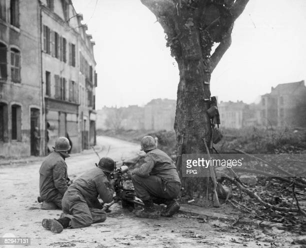American Combat Engineers manning a machine gun against German snipers in Metz, France, 22nd November 1944. The men are members of the 166th US Army...