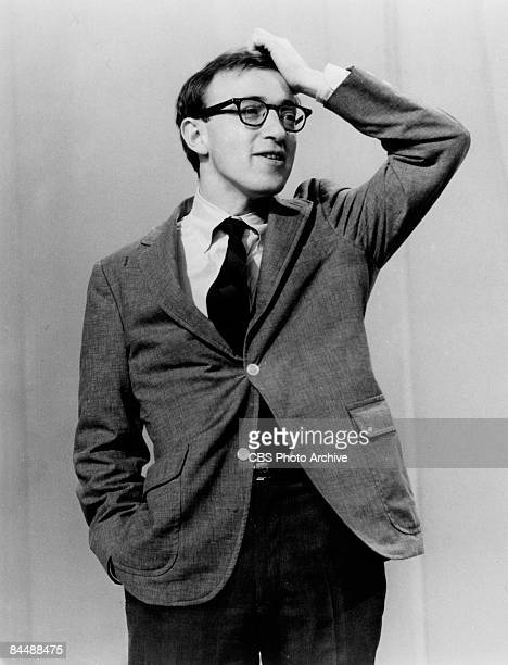 American comedian, actor, and director Woody Allen holds one hand to his head during a performance on an unspecified television show, January 27,...