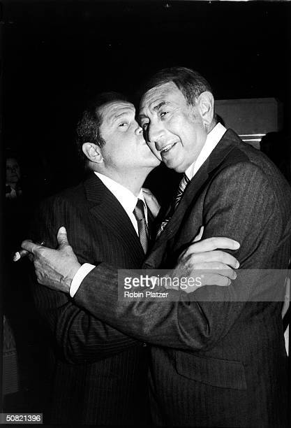 American comedian and actor Alan King kisses American sports commentator Howard Cosell on the cheek 1980