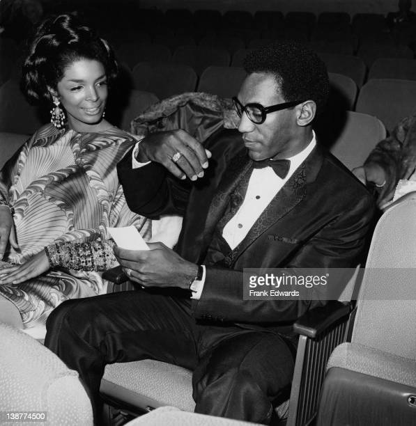 American comedian and actor Bill Cosby at the premiere of Franco Zeffirelli's 'Taming of the Shrew' with his wife Camille New York 8th March 1967