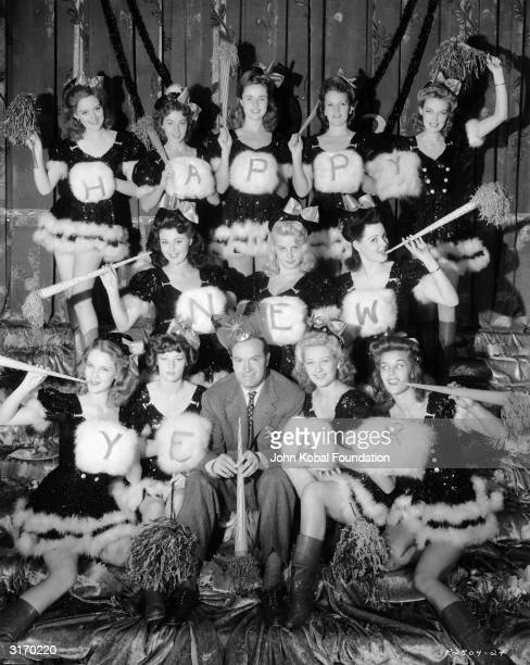 American comedian and actor Bob Hope surrounded by seasonally dressed Louisiana belles who appeared in the film 'Louisiana Purchace' directed by...