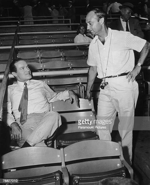 American comedian and actor Bob Hope with director Melville Shavelson on location at Yankee Stadium New York during filming of 'Beau James' a biopic...