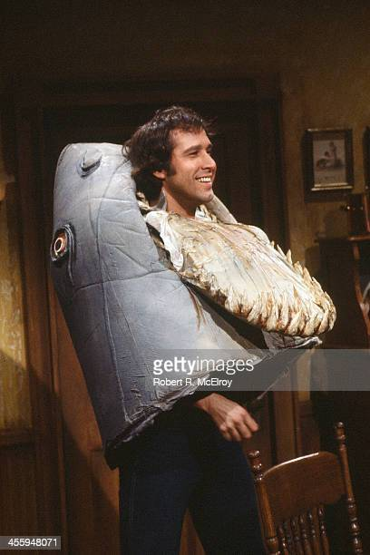 American comedian and actor Chevy Chase dressed in his iconic 'landshark' costume appears on an epsiode of the televison show 'Saturday Night Live'...
