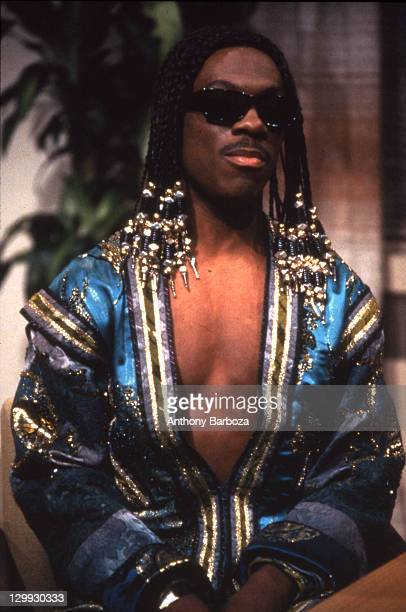 American comedian and actor Eddie Murphy performs as singer Stevie Wonder during a skit on the television show 'Saturday Night Live' New York New...