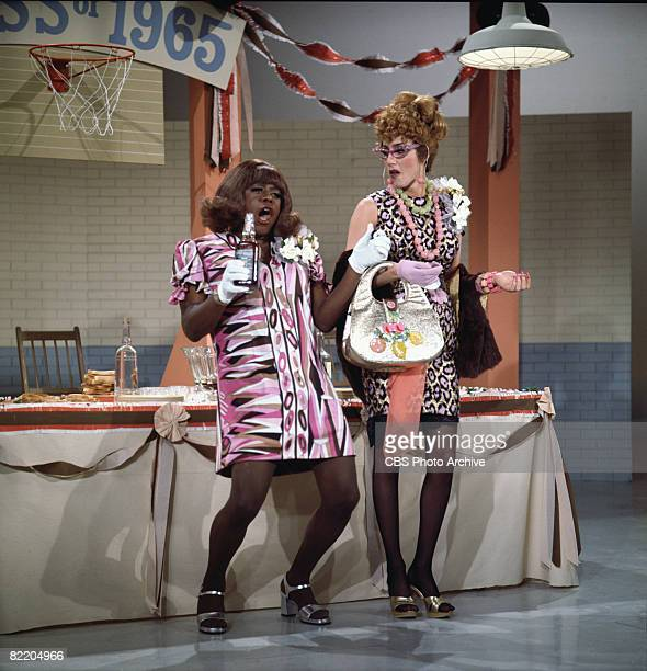 American comedian and actor Flip Wilson in costume as his popular 'Geraldine' character appear with American singer and actress Cher in a skit on the...