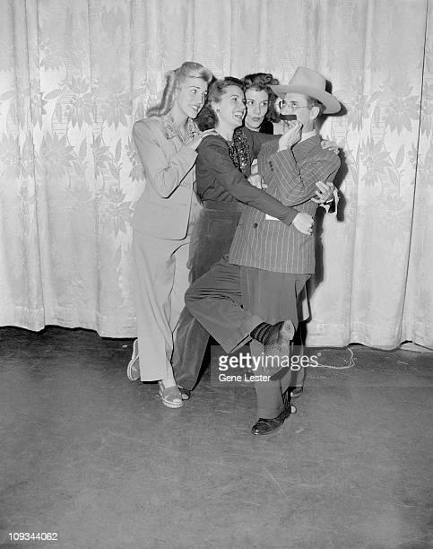 American comedian and actor Groucho Marx clowns around with musical group the Andrews Sisters early 1940s Pictured are from left Patty Andrews Maxene...