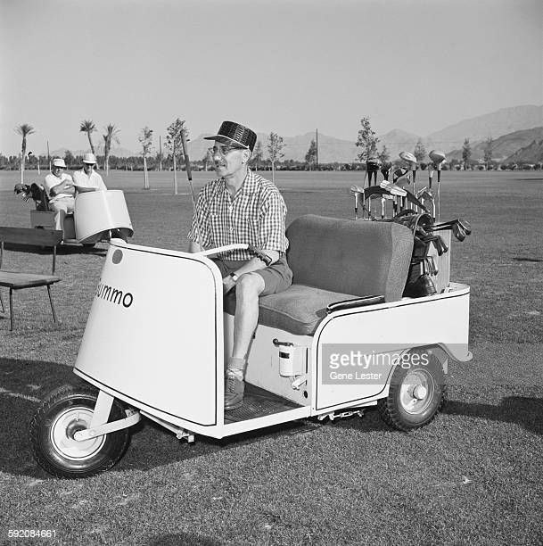American comedian and actor Groucho Marx rides in a golf cart on a golf course Palm Springs California early 1954