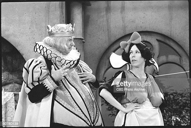 American comedian and actor Harvey Korman plays Prince Charming and American comedienne and actress Carol Burnett plays Snow White in a skit from...
