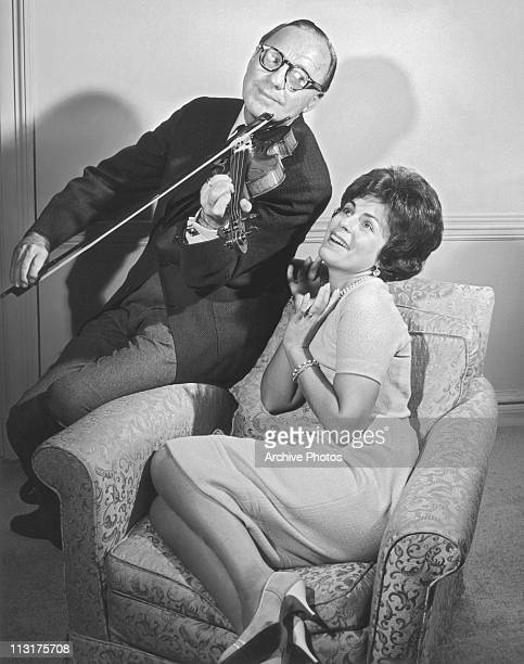 American comedian and actor Jack Benny with singer Roberta Peters on a television show in 1961
