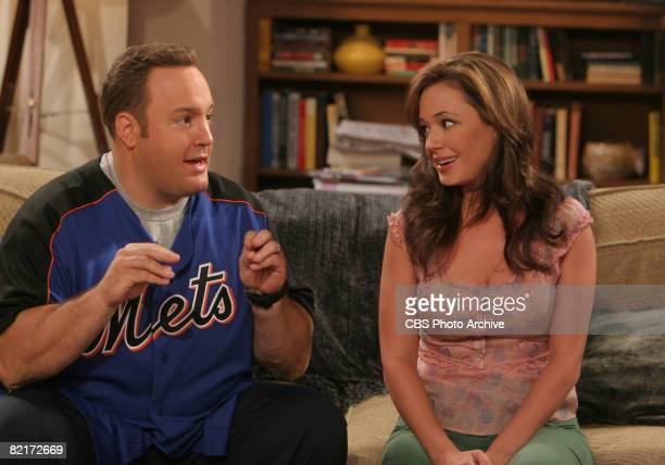 American comedian and actor Kevin James and actress Leah Remini as Doug and Carrie Heffernan sit side by side on a sofa in a scene from the...