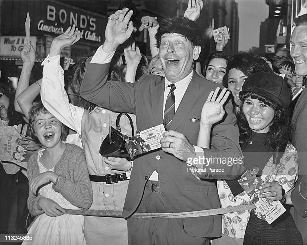 American comedian and actor Milton Berle with fans at the premiere for the Beatles film 'A Hard Day's Night' held at the Astor Theatre in New York on...