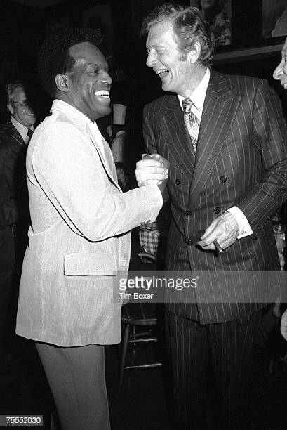 American comedian and actor Nipsey Russell and politician and New York mayor John Lindsay laugh as they clasp hands at an unidentified event early...