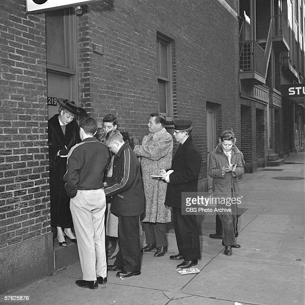 American comedian and actress Lucille Ball and her husband, Cuban-born American bandleader and actor Desi Arnaz , sign autographs for fans in an...