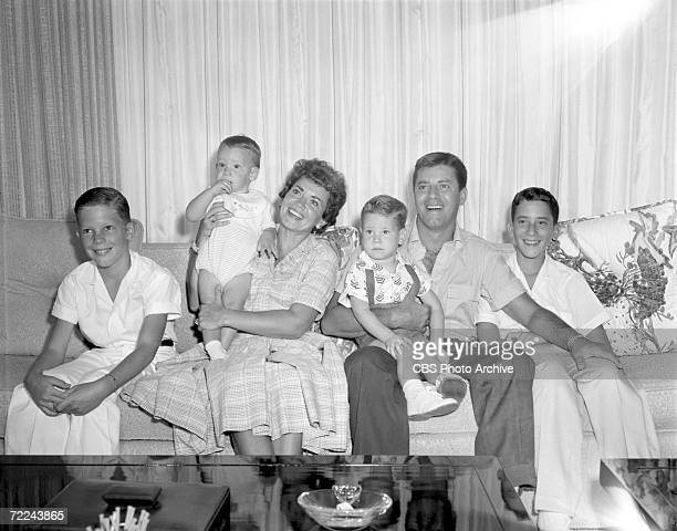 American comedian and film actor Jerry Lewis sits on a couch at home with his wife Patti and four sons Ronald Christopher Scott and Gary for an...