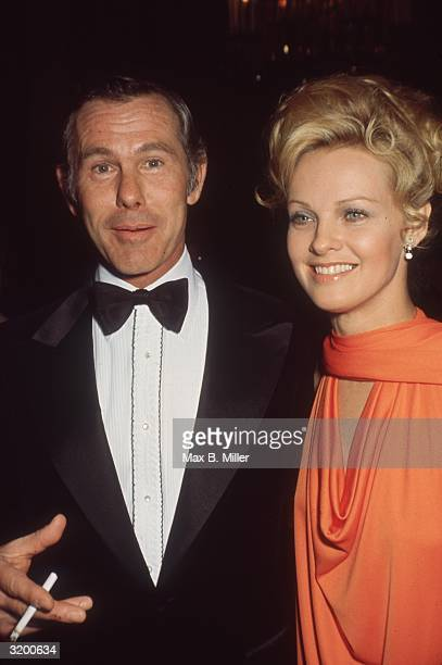 American comedian and television personality Johnny Carson and American actor Angel Tompkins attend the Golden Globe Awards where Tompkins was...