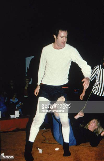American comedian Andy Kaufman stands up during a wrestling match against Elizabeth Hocker at the Comedy Store Los Angeles California December 1979