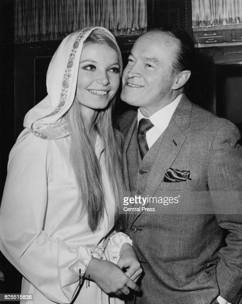 American comedian Bob Hope receives a kiss from Miss World 1969 Eva RueberStaier at the New Victoria Theatre in London 5th December 1969 She is his...