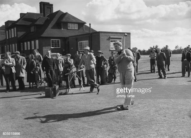 American comedian Bob Hope tees off watched by actor Bing Crosby at the Berkshire Club golf course at Sunningdale UK 19th September 1952 They are...