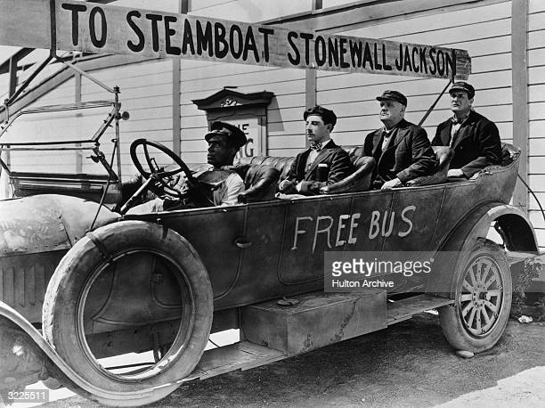 American comedian Buster Keaton and Scottishborn actor Ernest Torrence aboard a bus in a still from the film 'Steamboat Bill Jr' directed by Charles...