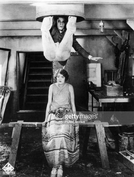 American comedian Buster Keaton hangs over Kathryn McGuire's head in a scene from 'The Navigator', directed by himself and Donald Crisp for MGM.