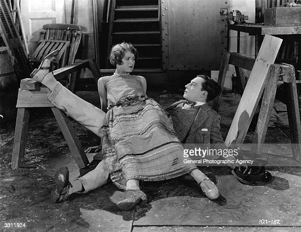 American comedian Buster Keaton stars with Kathryn McGuire in the MGM film 'The Navigator', which he also co-directed with Donald Crisp.