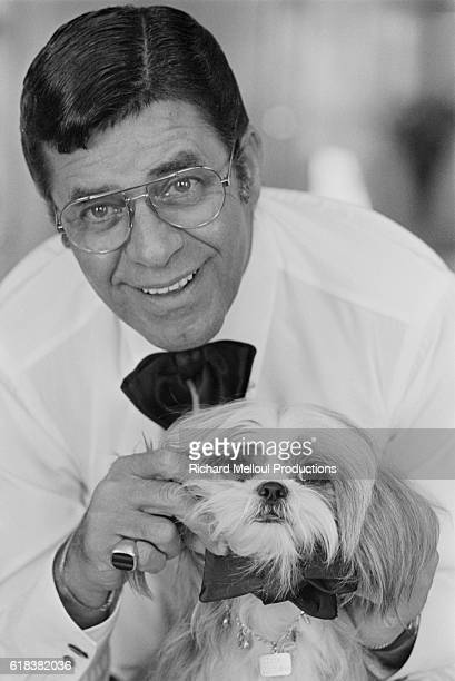 American Comedian director screenwriter and producer Jerry Lewis attends the 1982 Cannes Film Festival with his pet Shih Tzu