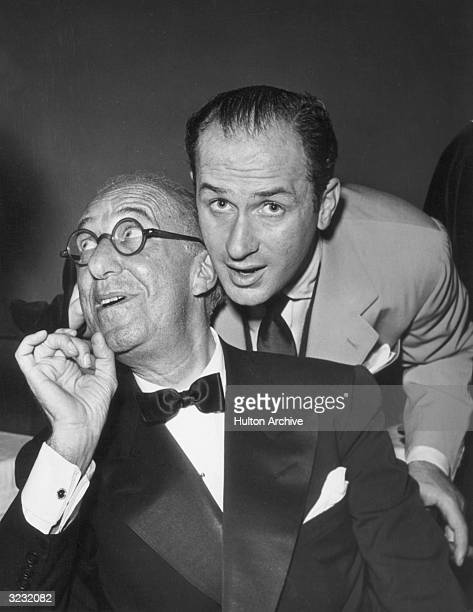 American comedian Ed Wynn clowns with his son, American actor and director Keenan Wynn , after seeing a revue that Keenan directed.